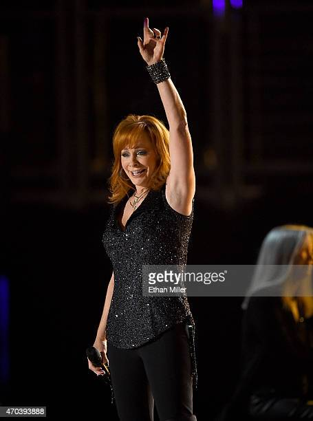 Honoree Reba McEntire performs onstage during the 50th Academy of Country Music Awards at ATT Stadium on April 19 2015 in Arlington Texas