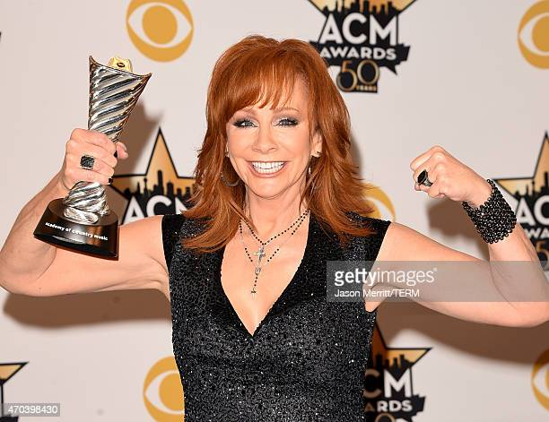 Honoree Reba McEntire recipient of the Milestone Award for Most Awarded ACM Female Vocalist of the Year poses in the press room at the 50th Academy...