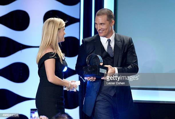 Honoree Reese Witherspoon accepts the American Cinematheque Award from actor Matthew McConaughey onstage during the 29th American Cinematheque Award...