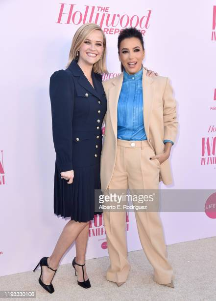 Honoree Reese Witherspoon and actor-producer Eva Longoria attend The Hollywood Reporter's Power 100 Women in Entertainment at Milk Studios on...