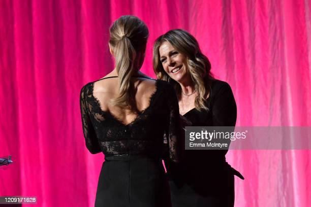 Honoree Renée Zellweger accepts the Courage Award from Rita Wilson onstage during WCRF's An Unforgettable Evening at Beverly Wilshire A Four Seasons...