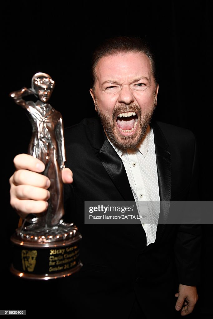 Honoree Ricky Gervais poses with the Charlie Chaplin Britannia Award for Excellence in Comedy during the 2016 AMD British Academy Britannia Awards presented by Jaguar Land Rover and American Airlines at The Beverly Hilton Hotel on October 28, 2016 in Beverly Hills, California.