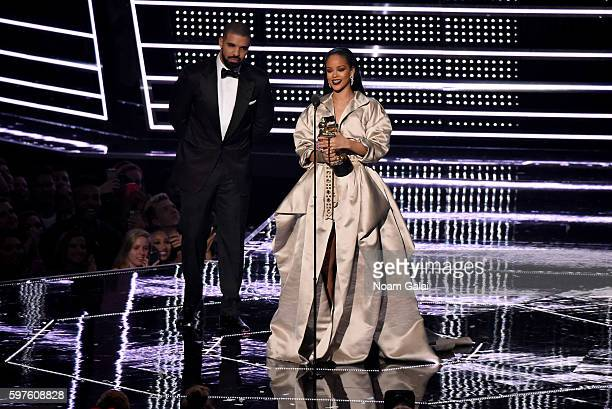Honoree Rihanna accepts the Michael Jackson Video Vanguard Award with recording artist Drake onstage during the 2016 MTV Video Music Awards at...