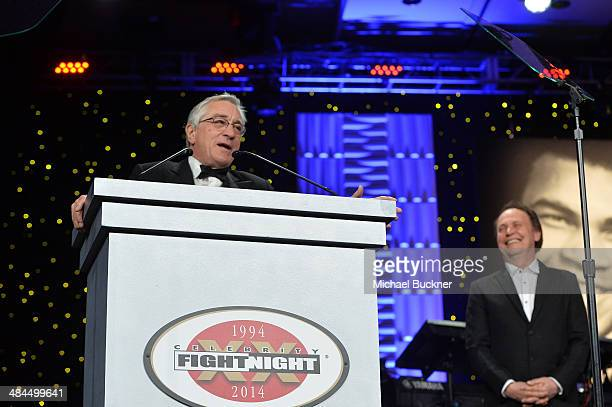 Honoree Robert De Niro accepts an award onstage with actor Billy Crystal during Muhammad Ali's Celebrity Fight Night XX held at the JW Marriott...