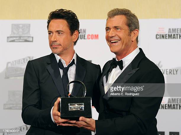 Honoree Robert Downey Jr and actor Mel Gibson pose with 25th Annual Cinematheque Award during The 25th American Cinematheque Award Honoring Robert...