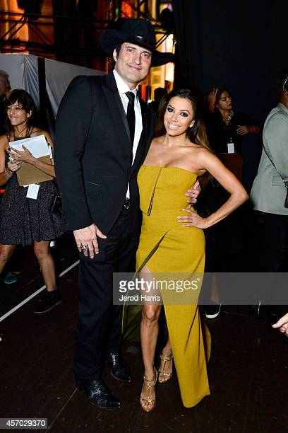 Honoree Robert Rodriguez and host Eva Longoria pose backstage at the 2014 NCLR ALMA Awards at the Pasadena Civic Auditorium on October 10 2014 in...