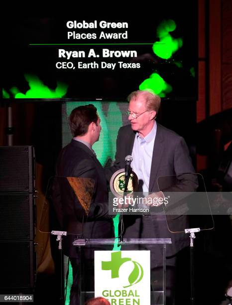 Honoree Ryan Brown and actor Ed Begley Jr speak onstage during the 14th Annual Global Green Pre Oscar Party at TAO Hollywood on February 22 2017 in...