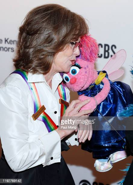 Honoree Sally Field gives Sesame Street character Abby Cadabby a hug and a kiss at the 42nd Annual Kennedy Center Honors Kennedy Center on December...