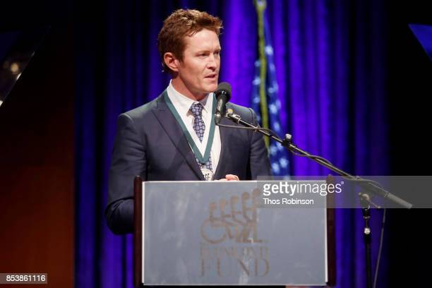 Honoree Scott Dixon speaks onstage at the 32nd Annual Great Sports Legends Dinner To Benefit The Miami Project/Buoniconti Fund To Cure Paralysis at...