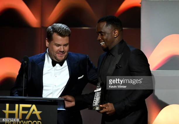 Honoree Sean Combs accepts the Hollywood Documentary Award for 'Can't Stop Won't Stop A Bad Boy Story' from host James Corden onstage during the 21st...