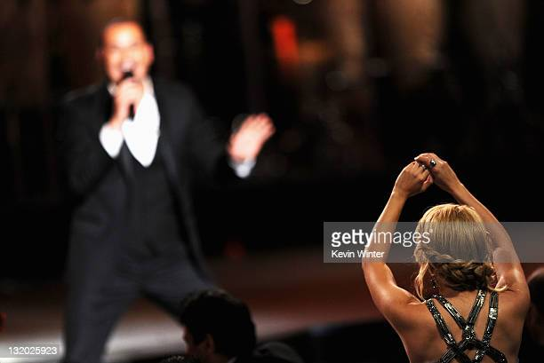 Honoree Shakira dances as Victor Manuelle performs onstage at the 2011 Latin Recording Academy Person Of The Year Honoring Shakira held at the...