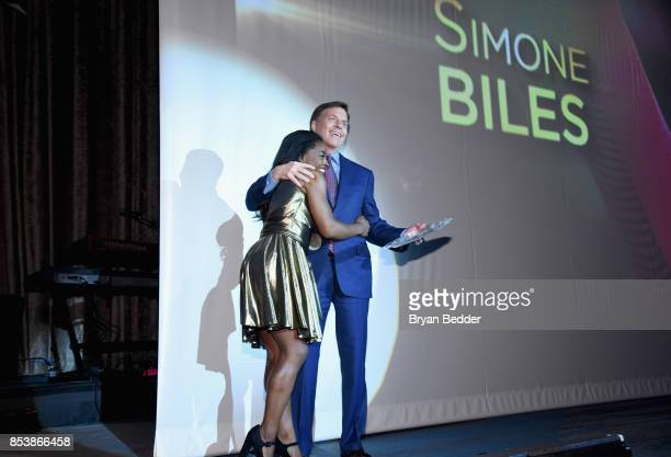 Honoree Simone Biles and Bob Costas speak onstage during the 32nd Annual Great Sports Legends Dinner To Benefit The Miami Project/Buoniconti Fund To...
