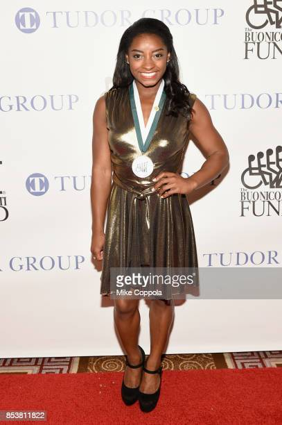 Honoree Simone Biles attends the 32nd Annual Great Sports Legends Dinner To Benefit The Miami Project/Buoniconti Fund To Cure Paralysis at New York...