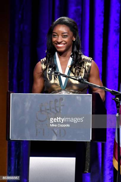 Honoree Simone Biles speaks onstage at the 32nd Annual Great Sports Legends Dinner To Benefit The Miami Project/Buoniconti Fund To Cure Paralysis at...