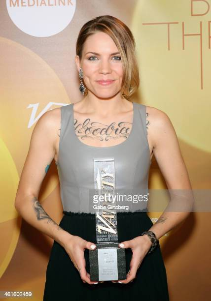 Honoree Skylar Grey poses backstage with the Breakthrough Award for Music Up Next at the Variety Breakthrough of the Year Awards during the 2014...