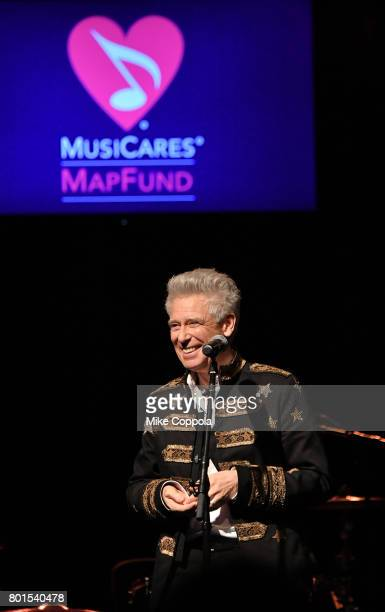Honoree Stevie Ray Vaughan Award recipient Adam Clayton of U2 gives his award acceptance speech at the 13th Annual MusiCares MAP Fund Benefit Concert...