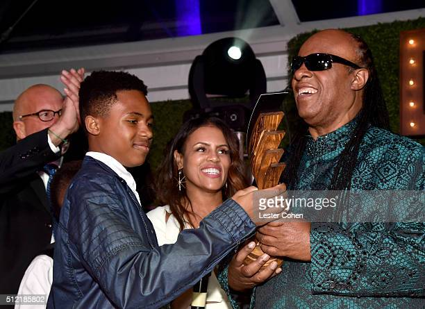 Honoree Stevie Wonder accepts the Global Green Hero Award with Kailand Morris and Kai Morris onstage during Global Green USA's 13th annual preOscar...
