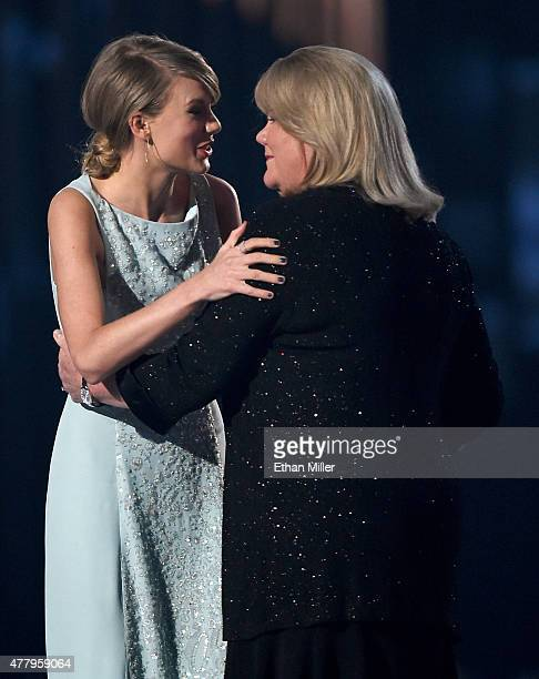 Honoree Taylor Swift accepts the 50th Anniversary Milestone Award for Youngest ACM Entertainer of the Year from her mother Andrea Finlay during the...