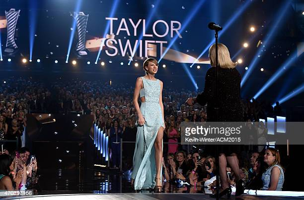 Honoree Taylor Swift accepts the 50th Anniversary Milestone Award from Andrea Swift onstage during the 50th Academy of Country Music Awards at ATT...