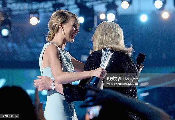 Honoree Taylor Swift accepts the Milestone Award from Andrea Finlay onstage during the 50th Academy of Country Music Awards at ATT Stadium on April...