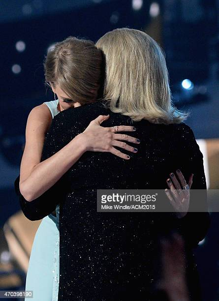 Honoree Taylor Swift accepts the Milestone Award from Andrea Finlay onstage during the 50th Academy of Country Music Awards at AT&T Stadium on April...