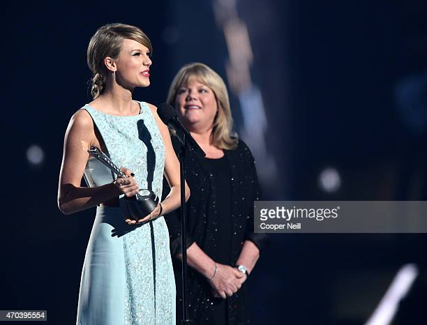 Honoree Taylor Swift accepts the Milestone Award from Andrea Swift onstage during the 50th Academy Of Country Music Awards at ATT Stadium on April 19...