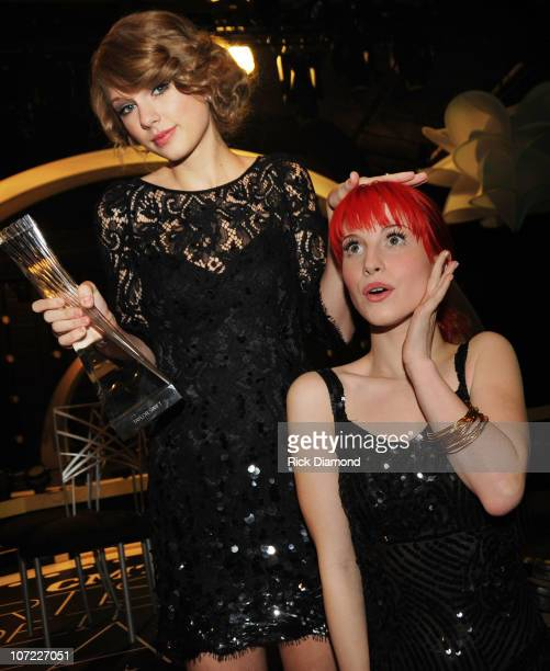Honoree Taylor Swift and Recording Artists Hayley Williams of the group Paramore and Kid Rock at the CMT Artists of the Year at The Factory on...