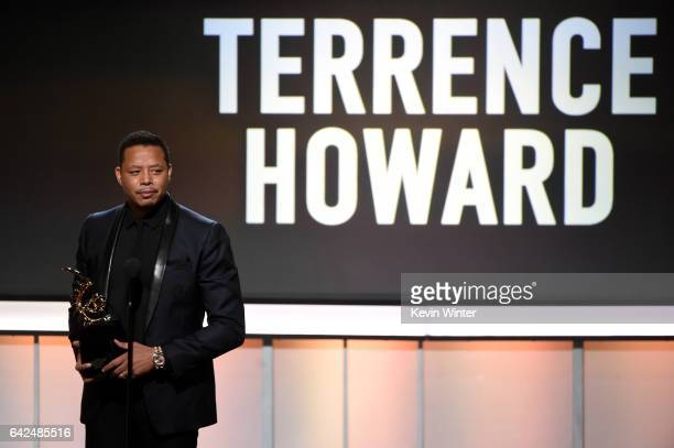 Honoree Terrence Howard accepts the Excellence in the Arts Award onstage during BET Presents the American Black Film Festival Honors on February 17...