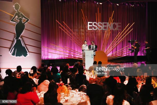 Honoree Tessa Thompson and Presenter Janelle Monae speak onstage during the 2018 Essence Black Women In Hollywood Oscars Luncheon at Regent Beverly...