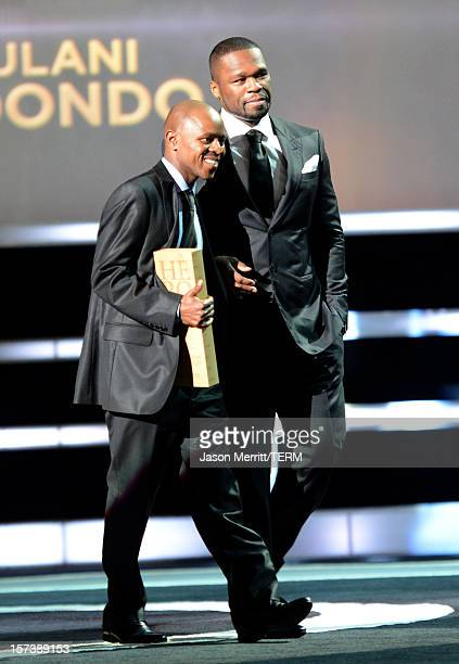 Honoree Thulani Madondo Executive Director of the Kliptown Youth Program and rapper/actor 50 Cent onstage during the CNN Heroes An All Star Tribute...