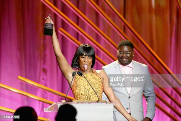 Honoree Tiffany Haddish and Presenter Lil Rel Howery onstage during the 2018 Essence Black Women In Hollywood Oscars Luncheon at Regent Beverly...