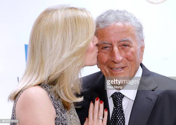 Honoree Tony Bennett's wife Susan Crow gives him a kiss at the Gershwin Prize Honoree's Tribute Concert at DAR Constitution Hall on November 15 2017...