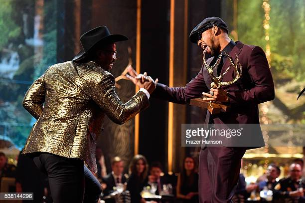 Honoree Von Miller accepts the Most Unstoppable Jock Award from recording artist RZA onstage during Spike TV's 10th Annual Guys Choice Awards at Sony...
