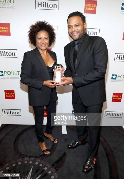 Honoree Wanda Sykes and Anthony Anderson at Point Honors Los Angeles 2017 benefiting Point Foundation at The Beverly Hilton Hotel on October 7 2017...