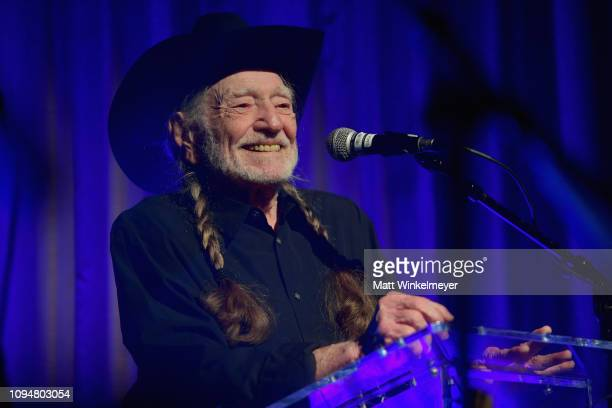 Honoree Willie Nelson speaks onstage during the Producers Engineers Wing 12th annual GRAMMY week event honoring Willie Nelson at Village Studios on...