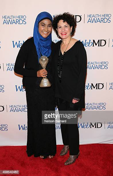 Honoree Zarin Idnat Rahman and comedian Susie Essman pose with an award backstage at the 2014 Health Hero Awards hosted by WebMD at Times Center on...