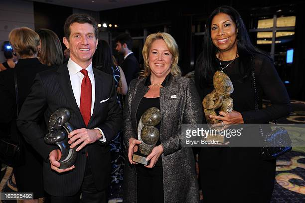 Honorees Alex Gorsky Amy Towers and Cookie Johnson attend the Elizabeth Glaser Global Champions of a Mothers Fight Awards Dinner at Mandarin Oriental...