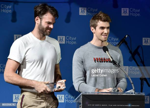 """Honorees Alex Pall and Andrew Taggart of The Chainsmokers accept the Pandora """"Trendsetter"""" Award at City of Hope's Music, Film and Entertainment..."""