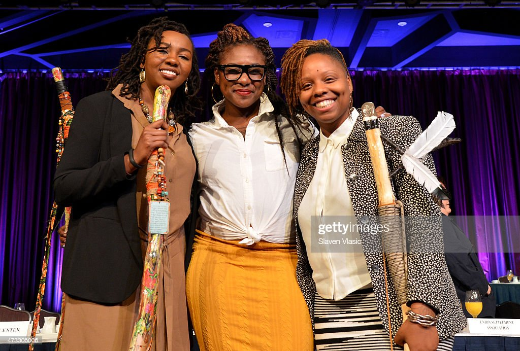 CWB honorees and co-founders of #BlackLivesMatter, Opal Tometi, Alicia Garza and Patrisse Cullors appear onstage during The New York Women's Foundation Celebrating Women Breakfast at Marriott Marquis Hotel on May 14, 2015 in New York City.