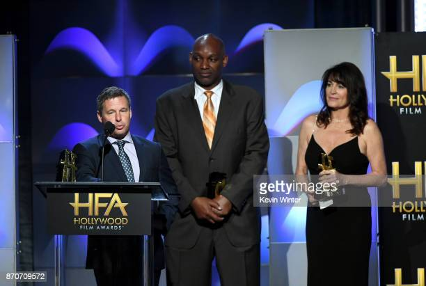 Honorees Andrew A Kosove Broderick Johnson and Cynthia Sikes Yorkin accept the Hollywood Producer Award for 'Blade Runner 2049' onstage at the 21st...