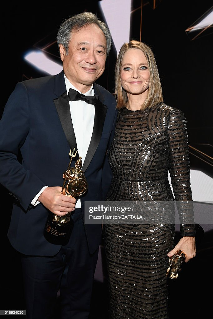 Honorees Ang Lee (L), recipient of the John Schlesinger Britannia Award for Excellence in Directing, and Jodie Foster, recipient of the Stanley Kubrick Britannia Award for Excellence in Film, attend the 2016 AMD British Academy Britannia Awards presented by Jaguar Land Rover and American Airlines at The Beverly Hilton Hotel on October 28, 2016 in Beverly Hills, California.