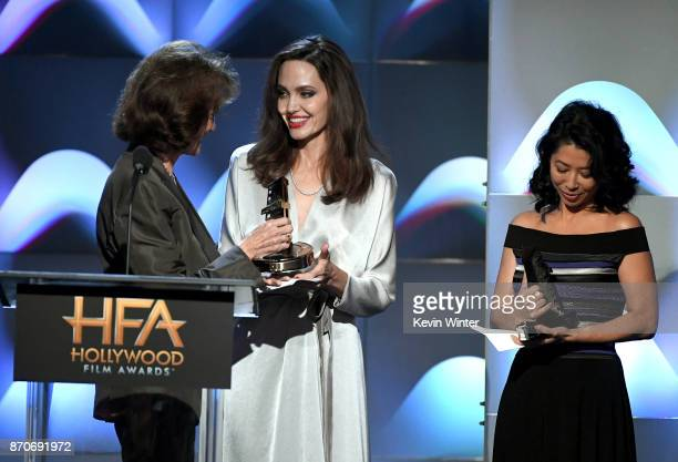 Honorees Angelina Jolie and Loung Ung accept the Hollywood Foreign Language Film Award for 'First They Killed My Father' from actor Jacqueline Bisset...