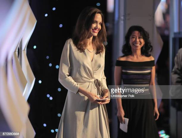 Honorees Angelina Jolie and Loung Ung onstage at the 21st Annual Hollywood Film Awards at The Beverly Hilton Hotel on November 5 2017 in Beverly...