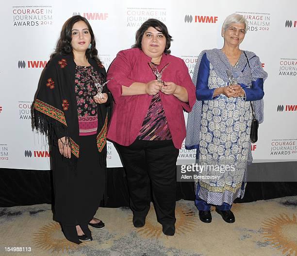 Honorees Asmaa alGhoul Khadija Ismayilova and Zubeida Mustafa arrive at the 2012 Courage in Journalism Awards hosted by the International Women's...