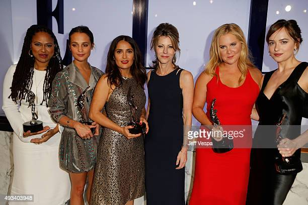 Honorees Ava DuVernay Alicia Vikander and Salma Hayek ELLE EditorinChief Robbie Myers and honorees Amy Schumer and Dakota Johnson pose onstage during...