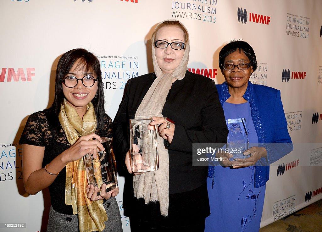 Honorees Bopha Phorn, Najiba Ayubi and Lifetime Achievement Award winner Edna Machirori attend the International Women's Media Foundation's 2013 Courage in Journalism Awards at the Beverly Hills Hotel on October 29, 2013 in Beverly Hills, California.