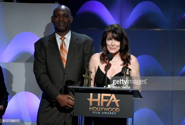 Honorees Broderick Johnson and Cynthia Sikes Yorkin accept the Hollywood Producer Award for 'Blade Runner 2049' onstage at the 21st Annual Hollywood...