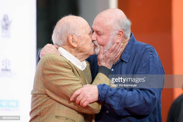 Honorees Carl Reiner and Rob Reiner embrace onstage during the Carl and Rob Reiner Hand and Footprint Ceremony during the 2017 TCM Classic Film...