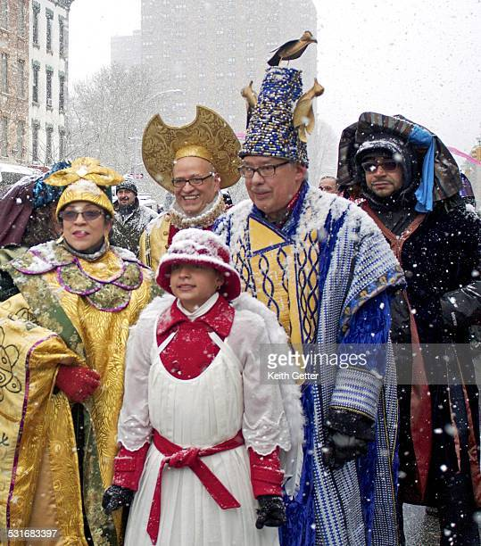 Honorees Celebrating in Costume and Hats at the Three Kings Day Annual Parade in Spanish Harlem Manhattan NYC on a snowy winter morning January 6 2015