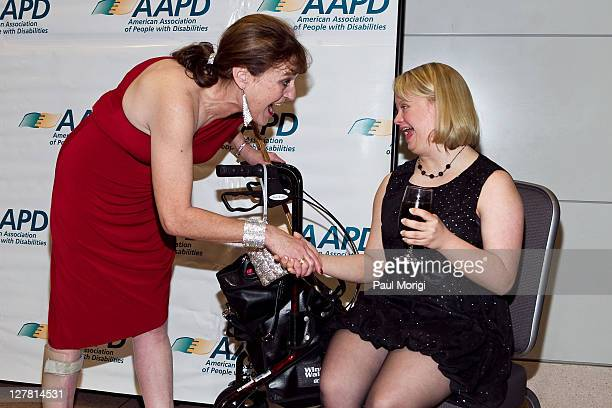 Honorees Cheryl Sensenbrenner and Glee's Lauren Potter greet one another at the 2011 AAPD Awards Gala at the Ronald Reagan Building on March 15 2011...